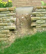 Hole in retaining wall