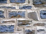 """Old stone retaining wall pointed with an economy """"Flush Joint"""""""